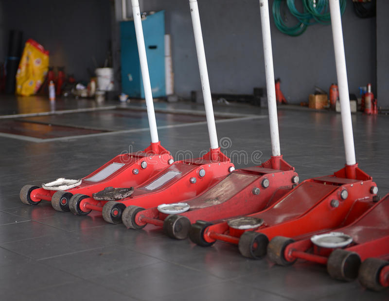 red jack lift in garage stock photography