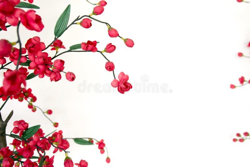 Red Japanese flowering cherry. Handmade cloth flower, Red Japanese flowering cherry royalty free stock photo
