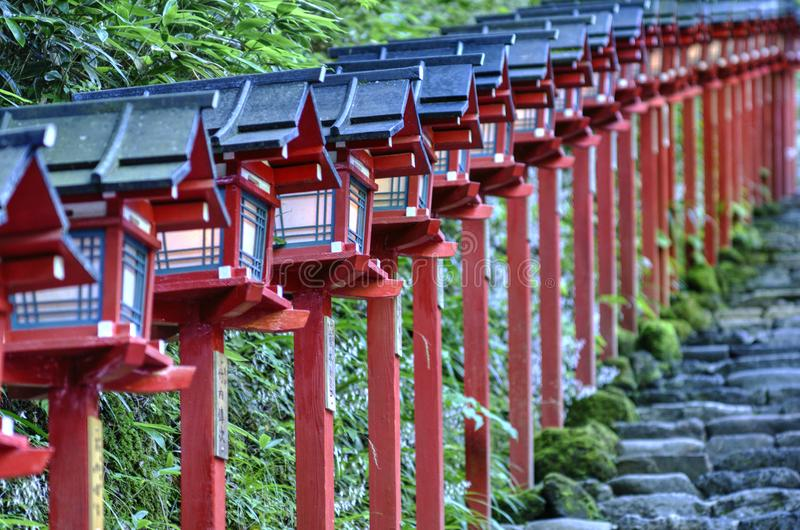 Red Japanese lanterns row in Kibune, Japan. Red Japanese lanterns in fron of Kibune shrine, Japan. Close up view with diagonal diraction royalty free stock image