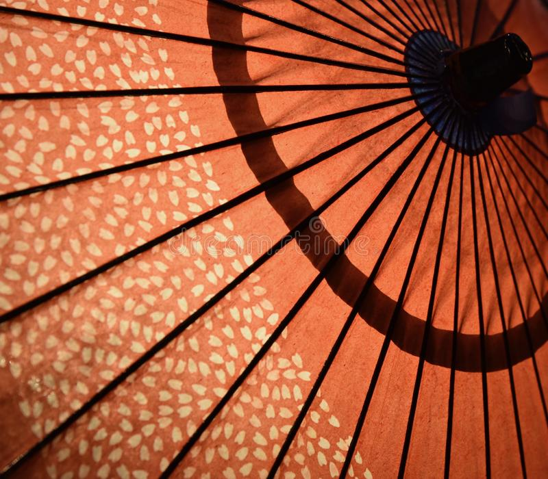 Red Japanese Umbrella in Kyoto JapanClose-up. Asian Japanese Umbrella on Display in Gion district`s walking street in Kyoto Japan royalty free stock image