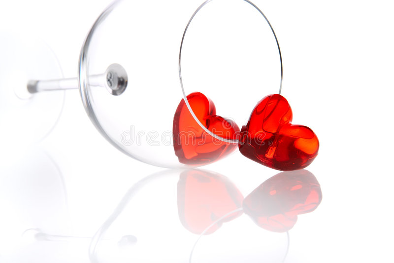 Red jelly hearts in wine glass stock photo