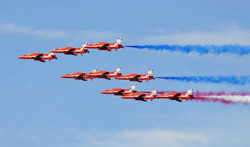 Red Jet Fighter Planes With Assorted Colors of Smoke on Horizon stock photos