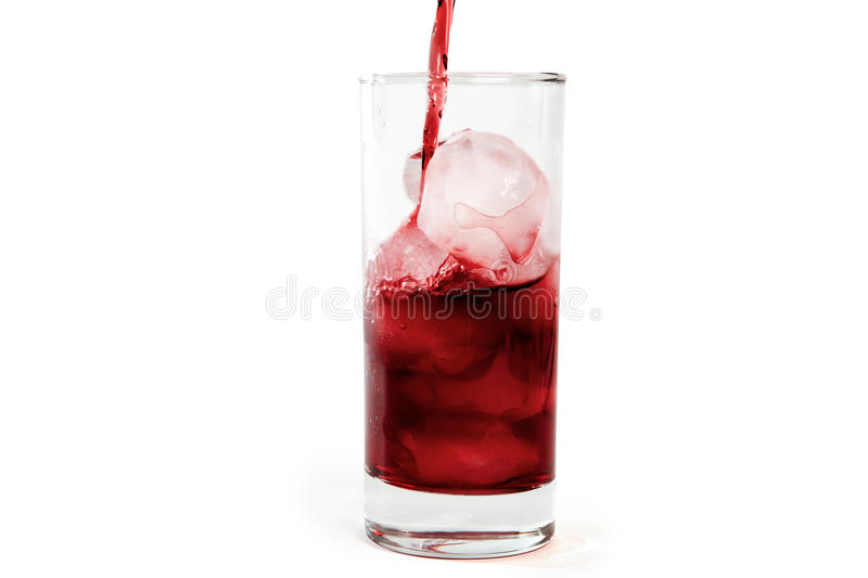 Red juice on ice cubes stock photo