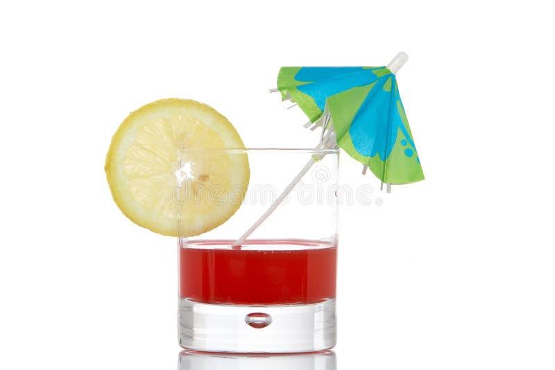 Red juice with umbrella stock photo
