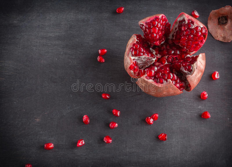 Download Red Juicy Ripe Pomegranate Grains On Dark Wooden Background. Stock Image - Image of food, juicy: 83720415