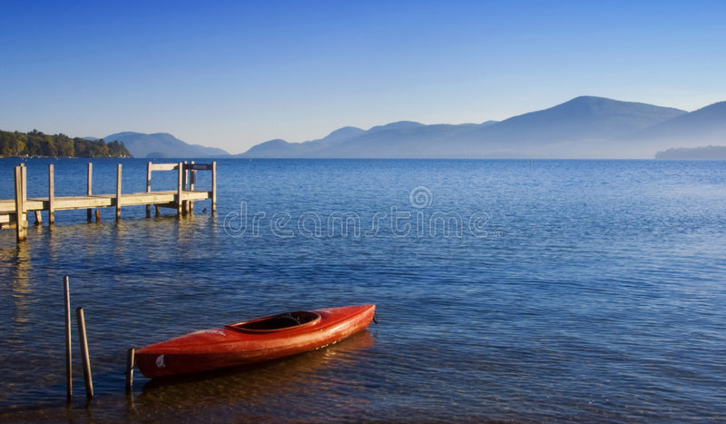 Red Kayak on Blue Water royalty free stock photo