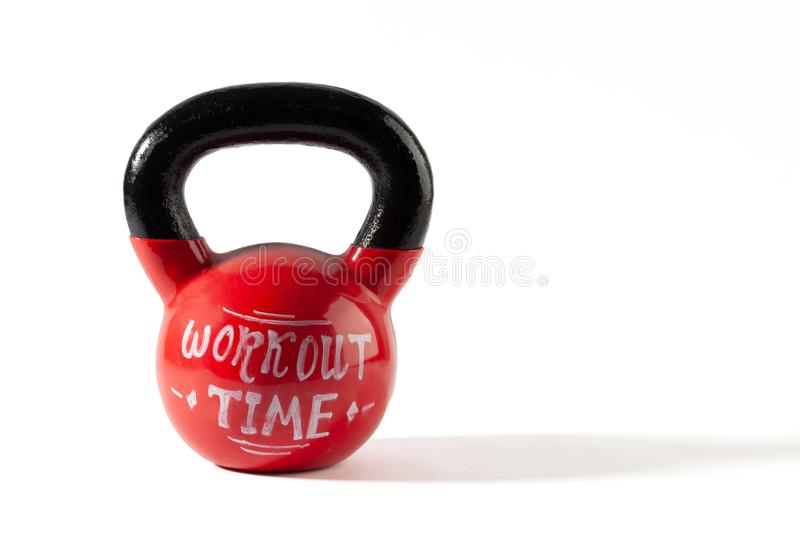 Red kettle bell with Workout Time lettering. Red kettle bell with Workout Time lettering isolated on white background with copy space stock photo