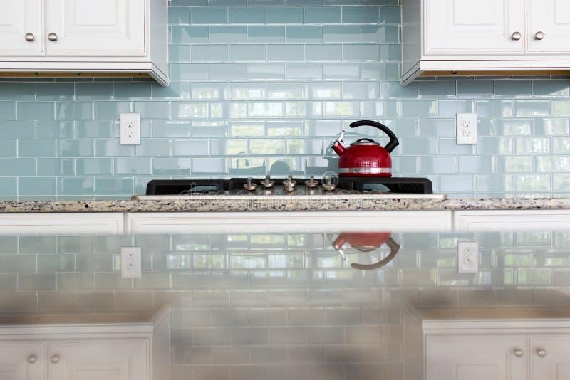 Red Kettle glass backsplash subway tile kitchen. Red kettle kitchen glass subway tile backsplash granite countertop stock images