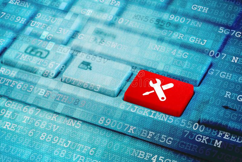 Red key with work tools icon on blue digital laptop keyboard royalty free stock photo