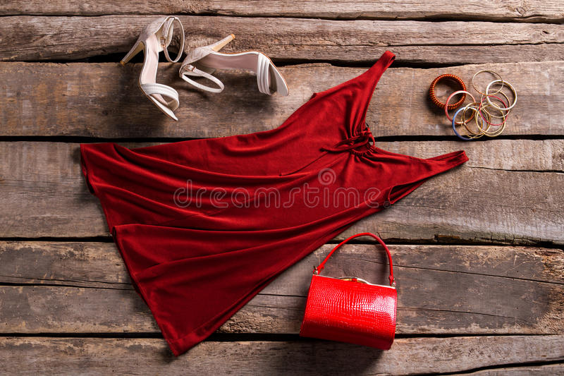 Red keyhole dress and accessories. stock photo