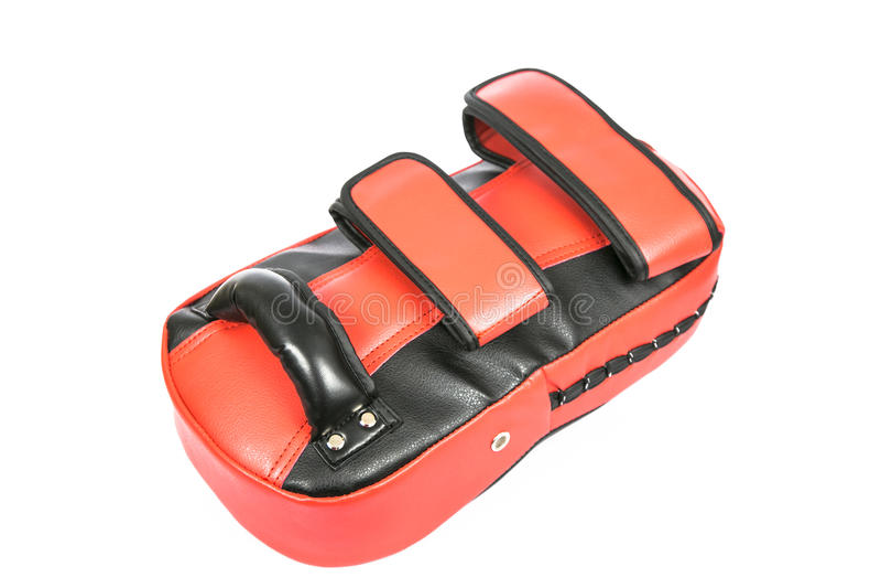 Red Kicking Shock shield glove on white background stock photo