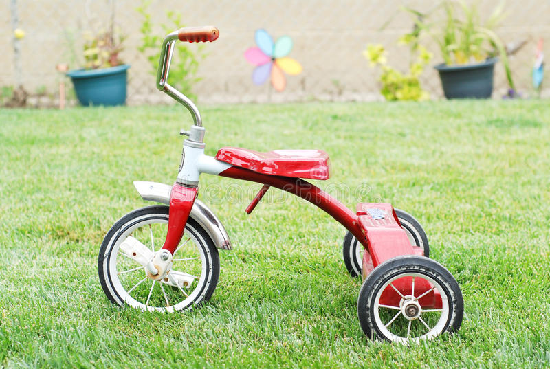 Red Kids Bike. Old Red Kids Bike on The Grass stock photography