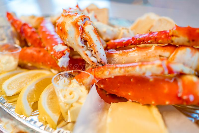 Red king crab legs with fresh lemon slices royalty free stock photos