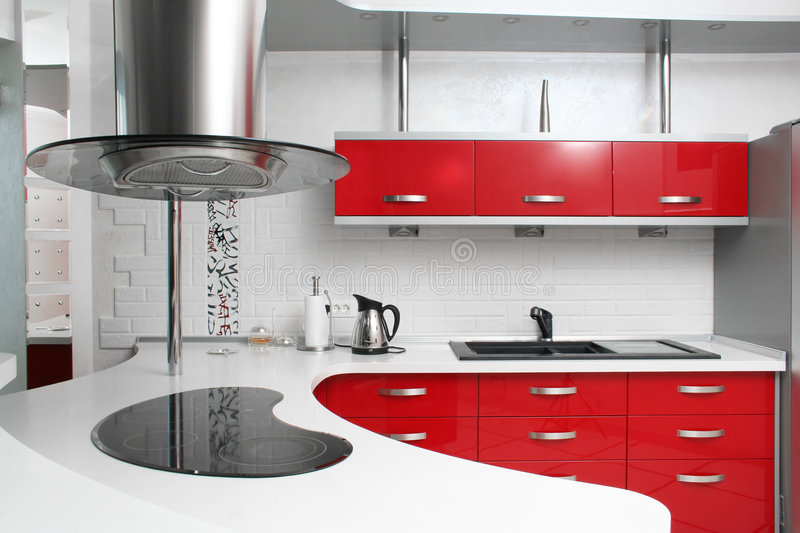 Red kitchen. Interior red kitchen with metal royalty free stock images