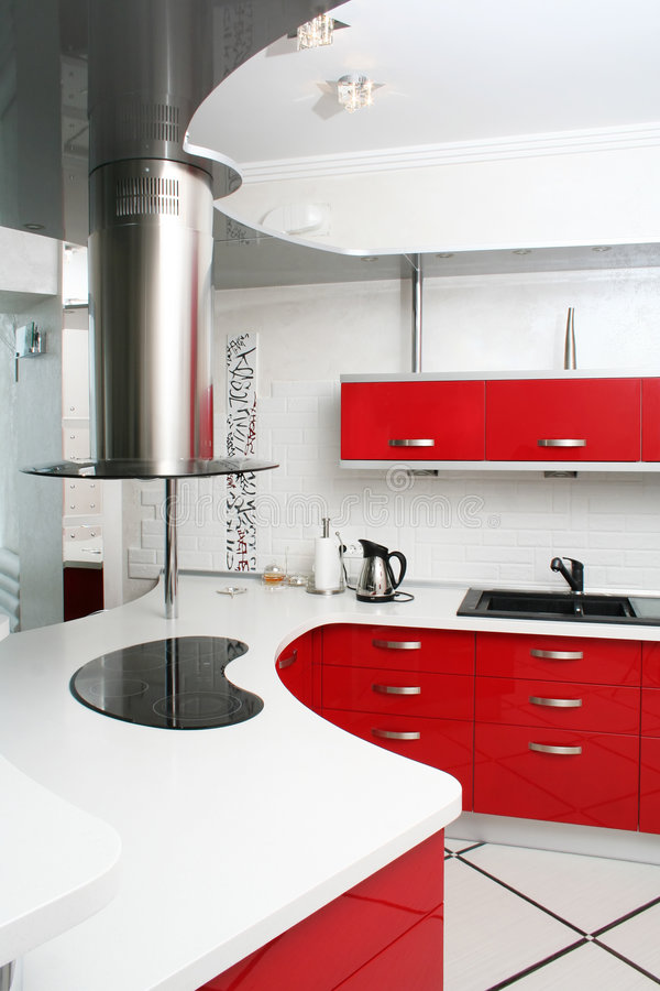 Red kitchen. Interior red kitchen with metal stock photo