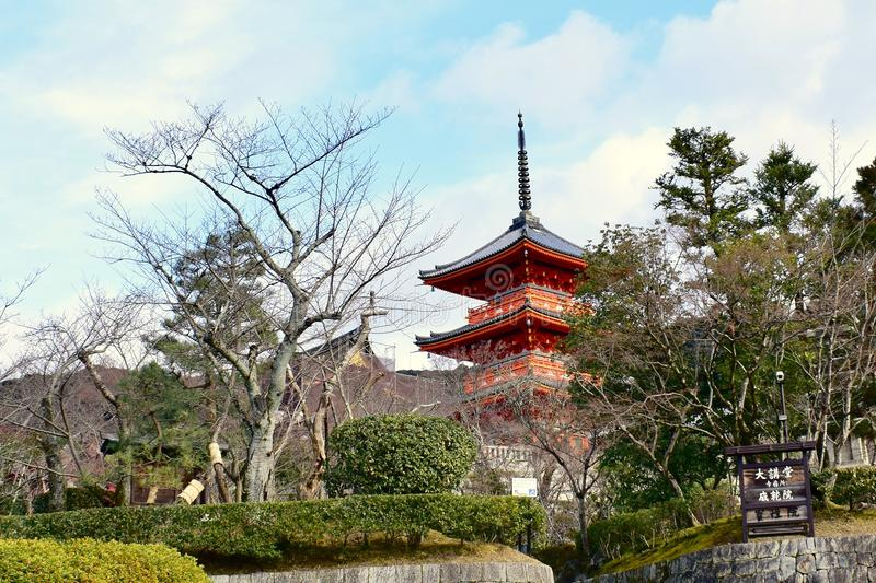 Red Kiyomizu-dera Temple around trees in winter, Kyoto, Japan. Red Kiyomizu-dera Temple around trees with blue sky in winter, Kyoto Japan stock image