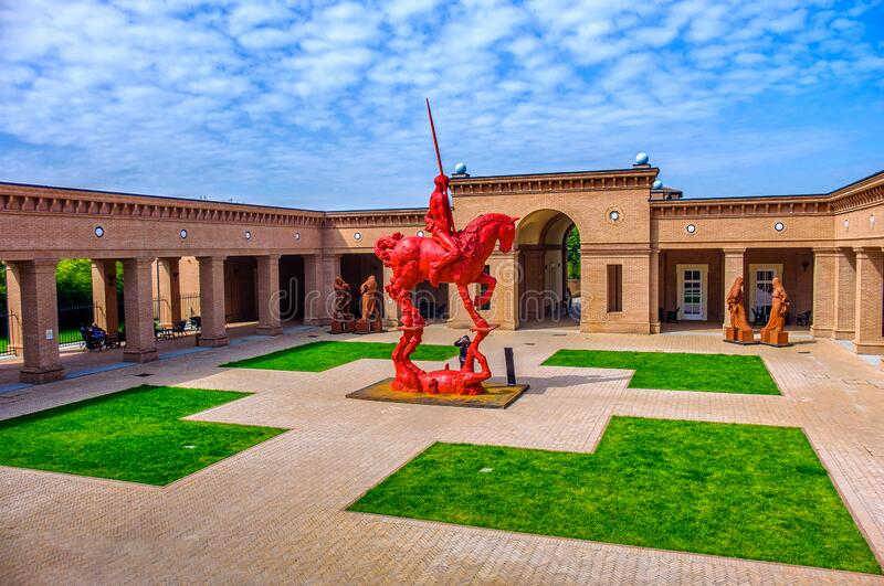 Red knight and horse with plaza background at the Masone Labyrinth Museum in Fontanellato - Parma - Italy royalty free stock photos