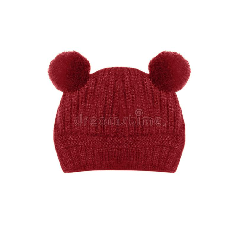 Red knitted baby hat with funny ears bear isolated on white stock photos