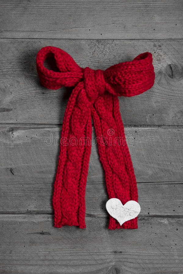 Download Red Knitted Bow With White Heart On Wooden Background For Christ Stock Photo - Image: 34548766