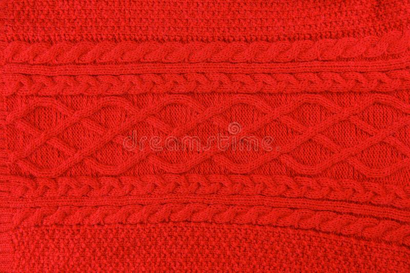 Red knitted textile as background royalty free stock photos