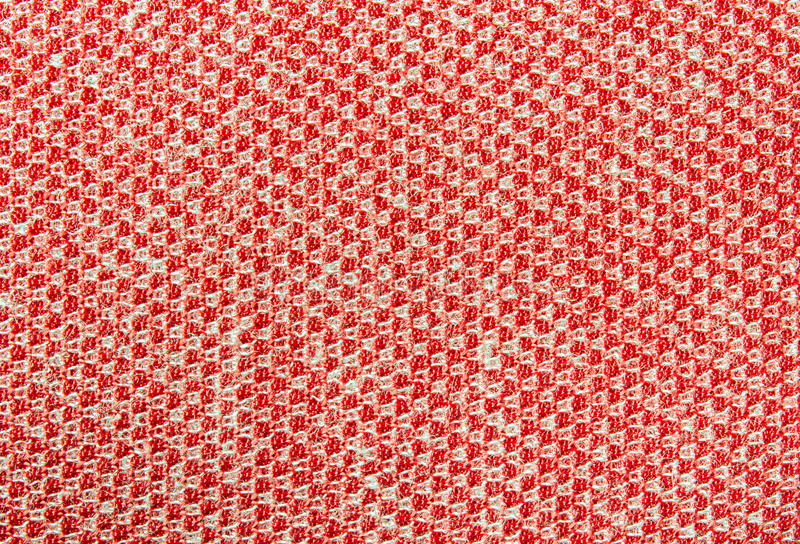 Red Knitting or Knitted Fabric Texture Pattern Background. Red knitting texture background or knitted fabric pattern background for design royalty free stock image