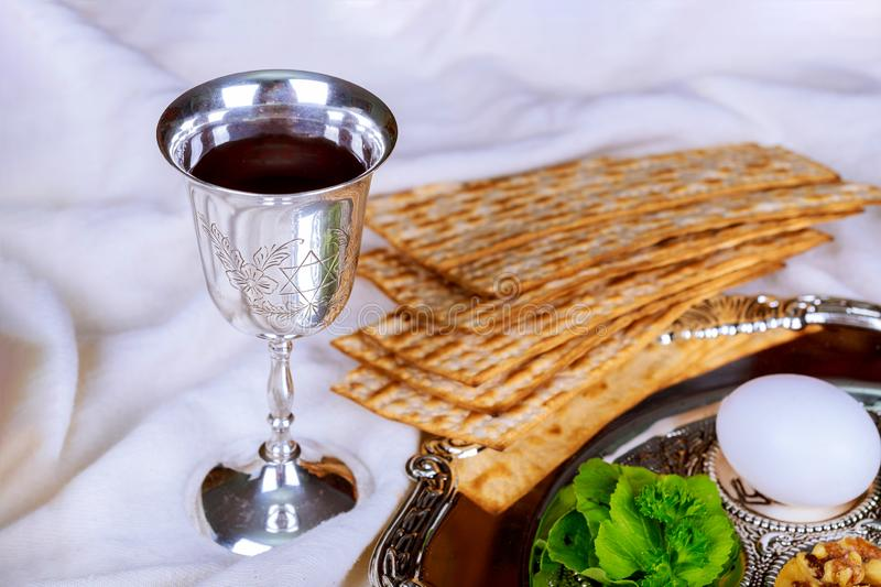 Red kosher wine four of matzah or matza Passover Haggadah. Red kosher glasses wine with a of matzah a Passover Haggadah stock photos
