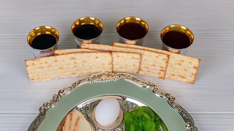 Red kosher wine four glasses of matzah or matza Passover Haggadah. Passover red kosher four glasses wine with a of matzah a haggadah celebration jewish holidays royalty free stock photo