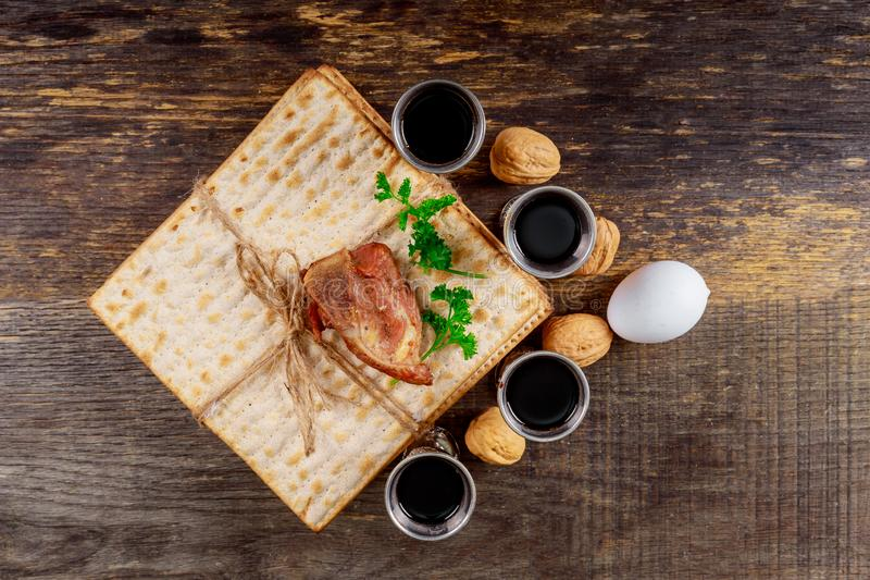 Red kosher wine four of matzah or matza Passover Haggadah. Red kosher four glasses wine with a of matzah a Passover Haggadah stock image