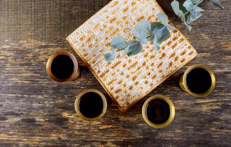 Red kosher wine four of matzah or matza Passover Haggadah. Red kosher four glasses wine with a of matzah a Passover Haggadah celebration jewish holidays seder royalty free stock photography