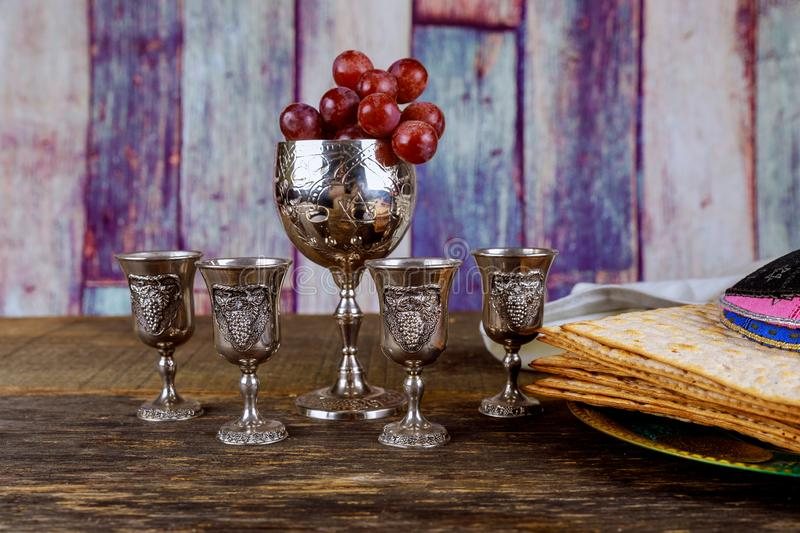 Red kosher wine four of matzah or matza Passover Haggadah. Red four glasses kosher wine with a of matzah a passover haggadah celebration jewish holidays seder stock photos