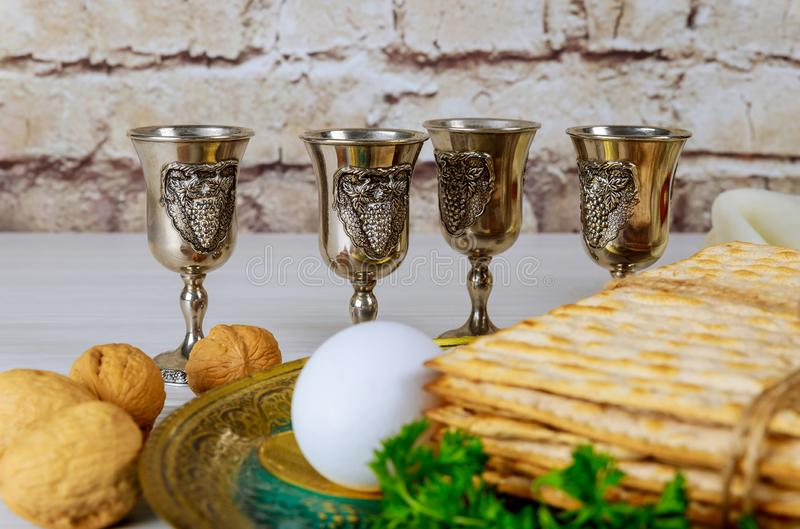 Red kosher wine four of matzah or matza Passover Haggadah. Red kosher four glasses wine with a of matzah a Passover Haggadah celebration jewish holidays seder royalty free stock photo