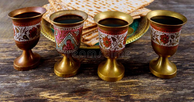 Red kosher wine four of matzah or matza Passover Haggadah. Red kosher four glasses wine with a of matzah a Passover Haggadah celebration jewish holidays seder royalty free stock images