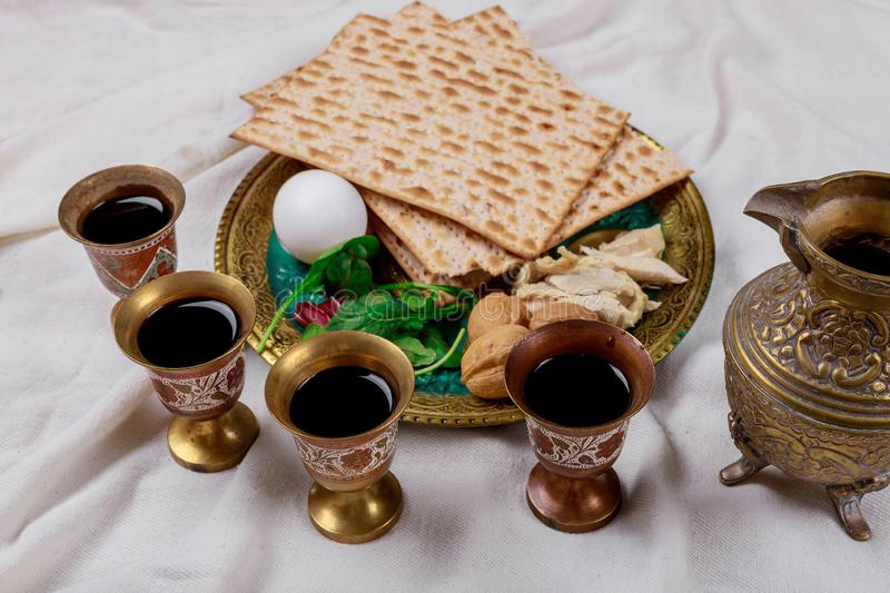 Red kosher wine four of matzah or matza Passover Haggadah. Red kosher four glasses wine with a of matzah a Passover Haggadah celebration jewish holidays seder stock images