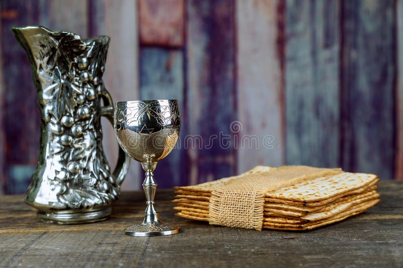 Red kosher wine with of matzah Passover Haggadah on a vintage wood background presented as a Passover seder meal. Red kosher wine with matzah a Passover Haggadah royalty free stock photos