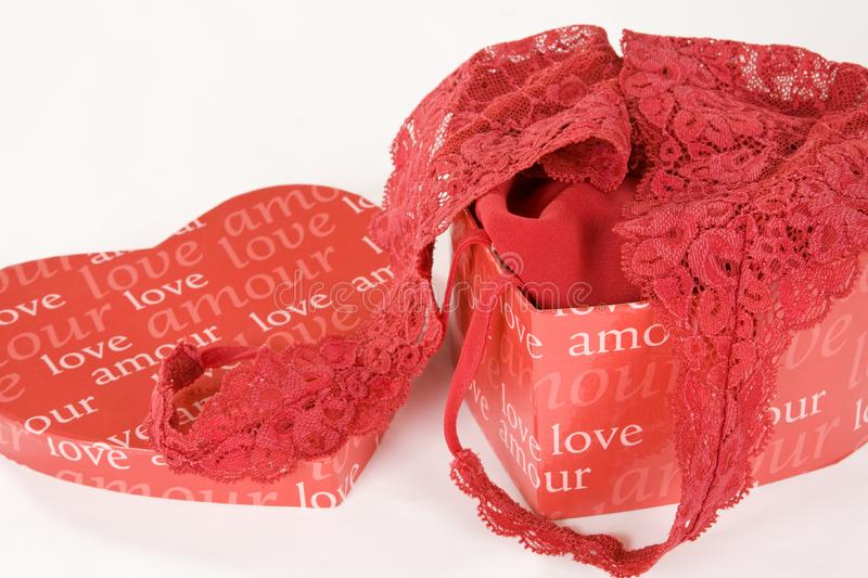 Red lace lingerie in heart shaped box stock photography