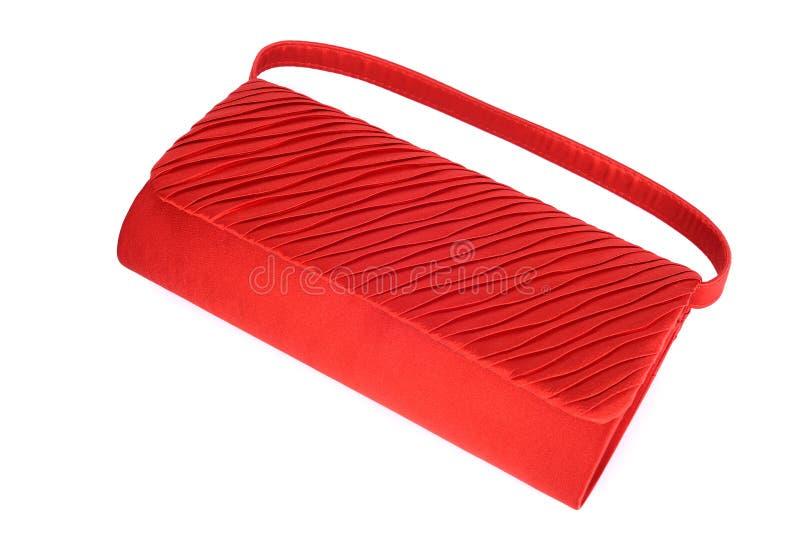 Red ladies handbag isolated on white