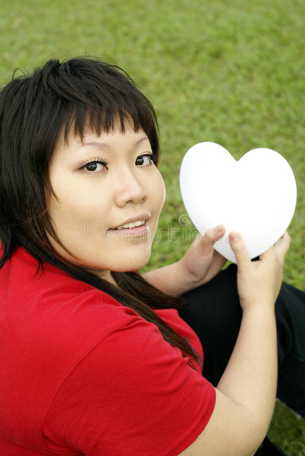 Download Red lady holding heart stock image. Image of symbolic - 10418251