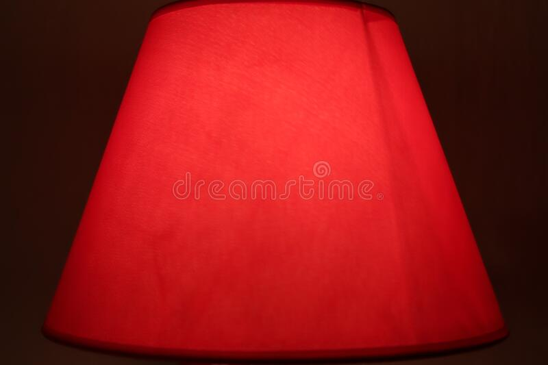Red lamp cover. Red night bedroom lamp cover stock photo
