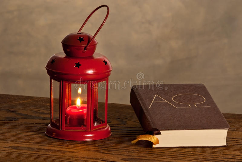 Red lantern with bible. On the wooden desk royalty free stock photography