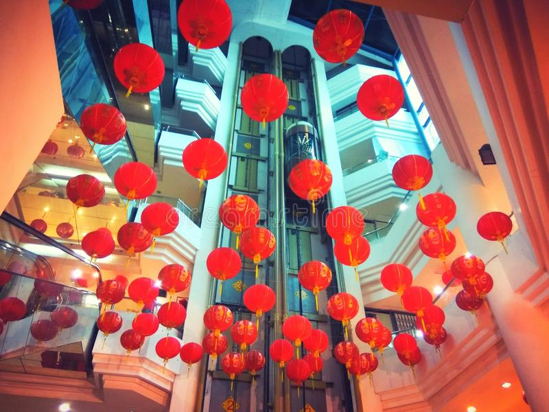Red lantern welcoming Chinese New Year. Red lantern decorations inside a building to welcome Chinese New Year royalty free stock image