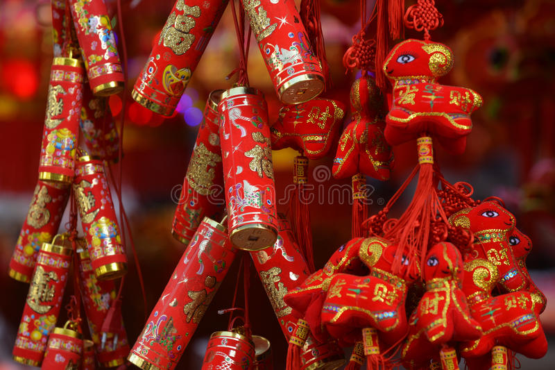 Red lanterns, red firecrackers, red pepper, red everyone, red Chinese knot, red packet...The Spring Festival is coming. Spring Festival ornaments shop full of stock photo