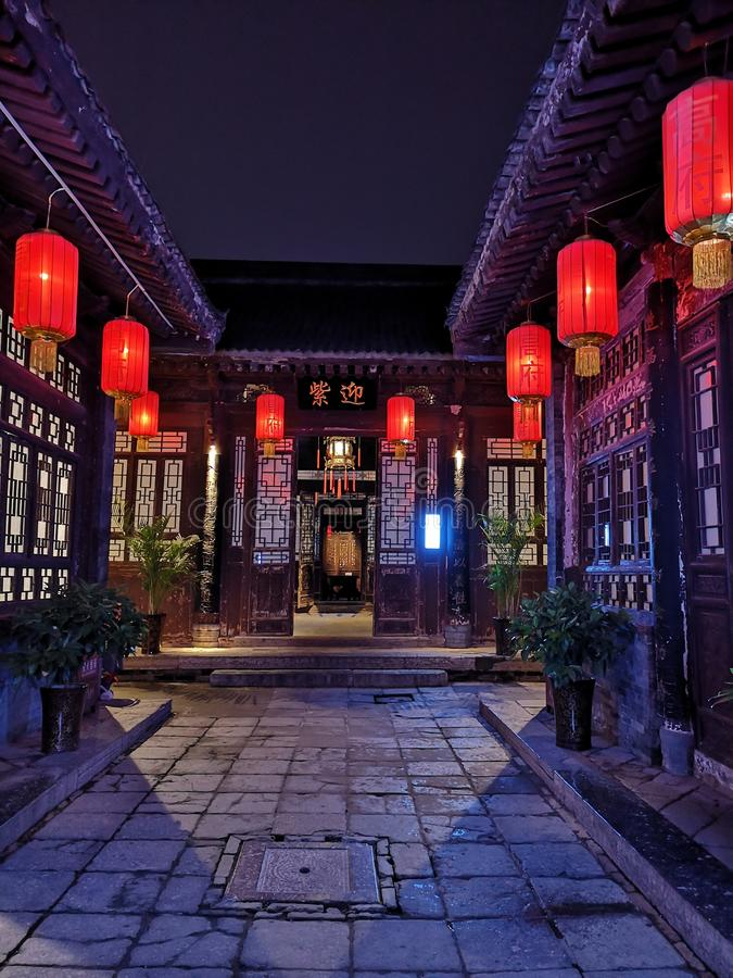 """Traditional quadrangle buildings and courtyards in north China. Red lanterns signal the arrival of the lunar New Year.,""""YinhlgZi"""" ,The stock photo"""