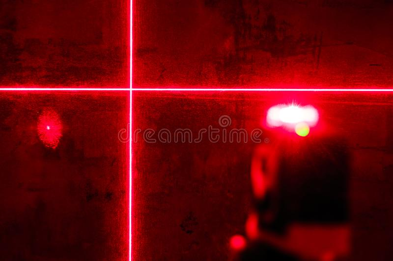 . red laser level. carving in a dark room. shallow depth of field stock images