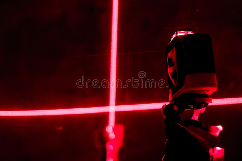 . red laser level. carving in a dark room. shallow depth of field royalty free stock image