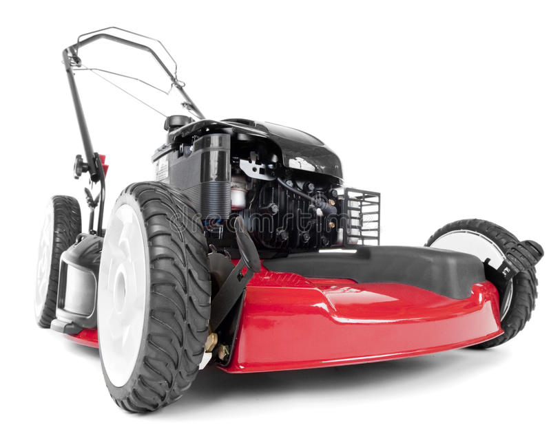 Red lawn mower. On white background royalty free stock photo