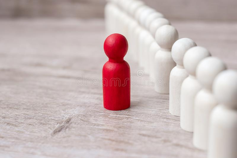 Red leader businessman with crowd of wooden men. leadership, business, team, teamwork and Human resource management concept stock image