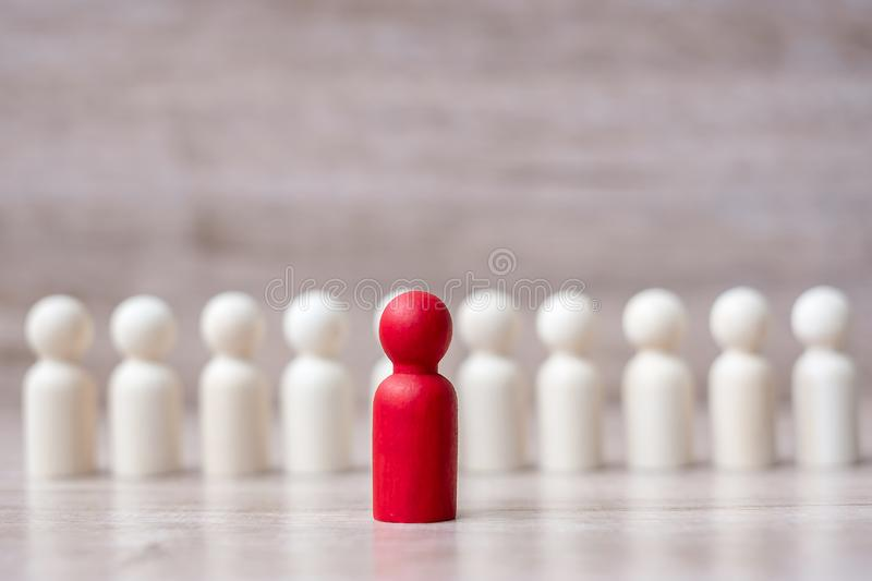 Red leader businessman with crowd of wooden men. leadership, business, team, teamwork and Human resource management concept.  stock photography