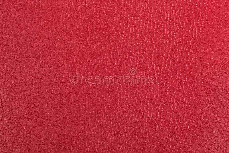 Red leather background. Seamless textured red leather background stock photos