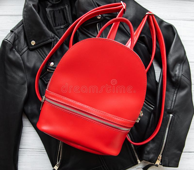 Red leather backpack. And womens clothing, flat lay royalty free stock images