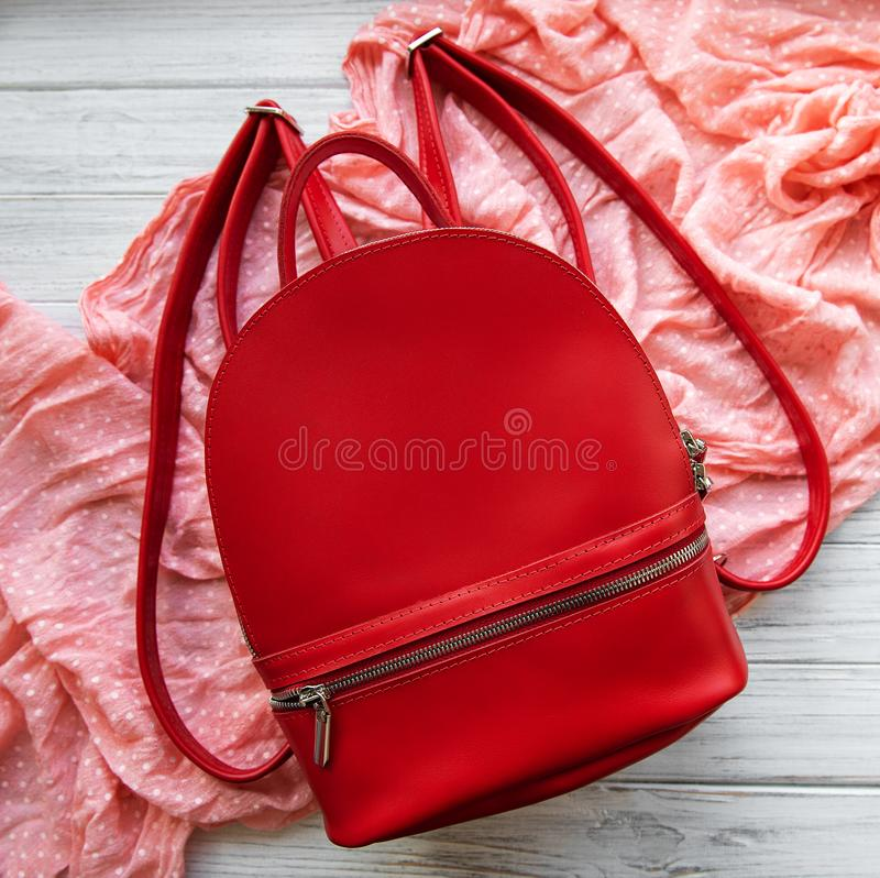 Red leather backpack. And womens clothing, flat lay stock photography